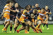 Darcy Graham is tackled by Rabz Maxwane during the Guinness Pro 14 2018_19 match between Edinburgh Rugby and Toyota Cheetahs at BT Murrayfield Stadium, Edinburgh, Scotland on 5 October 2018.