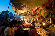 Sri Lanka. Mamangeshwarar festival. Sweet stalls at the open air market set up for the festival.