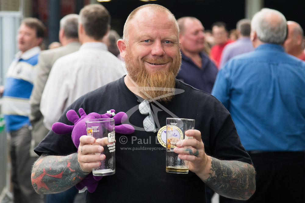 Olympia, London, August 9th 2015. Hundreds of real ale lovers attend the Campaign for Real Ale  Great British Beer Festival at London's Olympia Exhibition Centre, where dozens of independent breweries demonstrate the diversity of British brewed beers. PICTURED: A man heads to the bar for a refill.