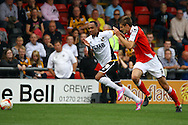 Port Vale's Byron Moore and Crewe Alexandre's Jon Guthrie chase the ball. Skybet football league one match, Crewe Alexandra v Port Vale at the Alexandra Stadium in Crewe on Saturday 13th Sept 2014.<br /> pic by Chris Stading, Andrew Orchard sports photography.