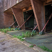 Architectural landscape of missile silo doors entrance at the former nuclear weapons-era airfield occupied by US Air force personnel during the Cold War and now vacant, awaiting re-landscaping and returning to common parkland for the public to use. Opened in 1942, it was used by both the Royal Air Force and United States Army Air Forces during World War II and the United States Air Force during the Cold War. After the Cold War ended, it was closed in 1993. The airfield was also known for the Greenham Common Women's Peace Camp held outside its gates in the 1980s. In 1997 Greenham Common was designated as public parkland.