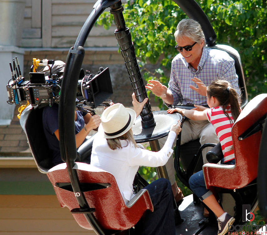 """Michael Douglas, right, and Diane Keaton ride with a camera operator during filming of the movie """"And So It Goes"""" on Monday at Lake Compounce in Bristol. (Photo by Kevin Bartram)"""