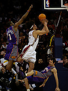 MORNING JOURNAL/DAVID RICHARD.Cleveland's Anderson Varejao, center, puts up a shot between Amare Stoudemire, left, and Steve Nash of Phoenix. Nash was whistled for a blocking foul.
