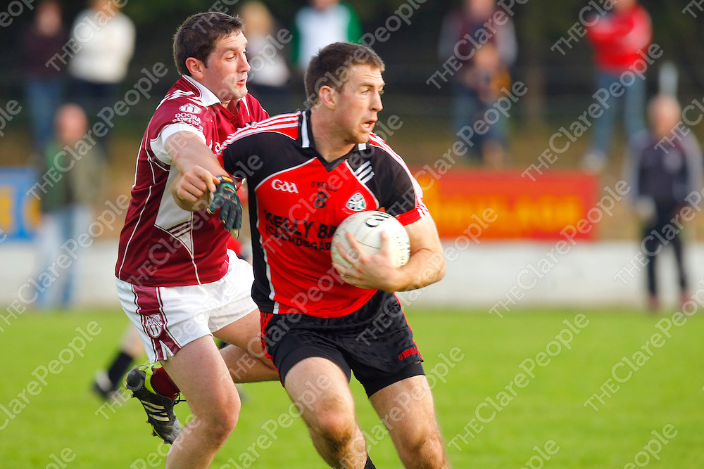 26/08/2012<br /> Gary Brennan of Clondegad  breaks away from Paul Dullaghan of St Josephs Doora Barefield at Lissycasey on Sunday.<br /> Pic: Don Moloney/Press 22