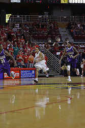 12 December 2009: Lloyd Phillips brings the ball to the Redbirds end flanked by Anthony Nelson and Kashief Edwards. The Purple Eagles of Niagara defeat the Redbirds of Illinois State 76-68 on Doug Collins Court inside Redbird Arena in Normal Illinois.