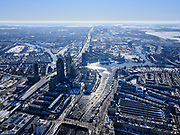 Nederland, Noord-Holland, Amsterdam, 13-02-2021; winter in Amsterdam, Amstelstation en omgeving, zicht op rivier de Amstel. <br /> Winter in Amsterdam, Amstel station and surroundings, view of the Amstel river.<br /> <br /> luchtfoto (toeslag op standaard tarieven);<br /> aerial photo (additional fee required)<br /> copyright © 2021 foto/photo Siebe Swart