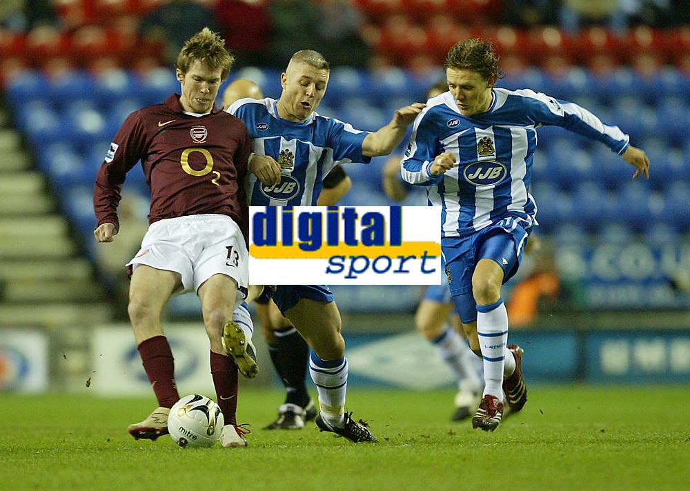 Photo: Aidan Ellis.<br /> Wigan Athletic v Arsenal. Carling Cup. Semi Final, 1st Leg.<br /> 10/01/2006.<br /> Arsenal's Alexander Hleb hols off Wigan's Graham Kavanagh and Jimmy Bullard