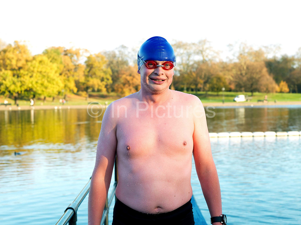 Portrait of James, a member of the Serpentine Swimming Club, Hyde Park, London, UK. The Serpentine Lake is situated in Hyde Park, London's largest central open space. The Serpentine Swimming Club was formed in 1864 'to promote the healthful habit of bathing in open water throughout the year'.  Its headquarters were beneath an old elm tree on the south side of the lake, a wooden bench for clothing being the only facility.  At this time London was undergoing rapid expansion and Hyde Park was now in the centre of a densely populated built up area and provided a place of relaxation to its urbanised masses. Now, the club has its own (somewhat spartan) changing facilities and members are  permitted by the Royal Parks to swim in the lake any morning before 09:30.  They race every Saturday morning throughout the year, regardless of the weather.