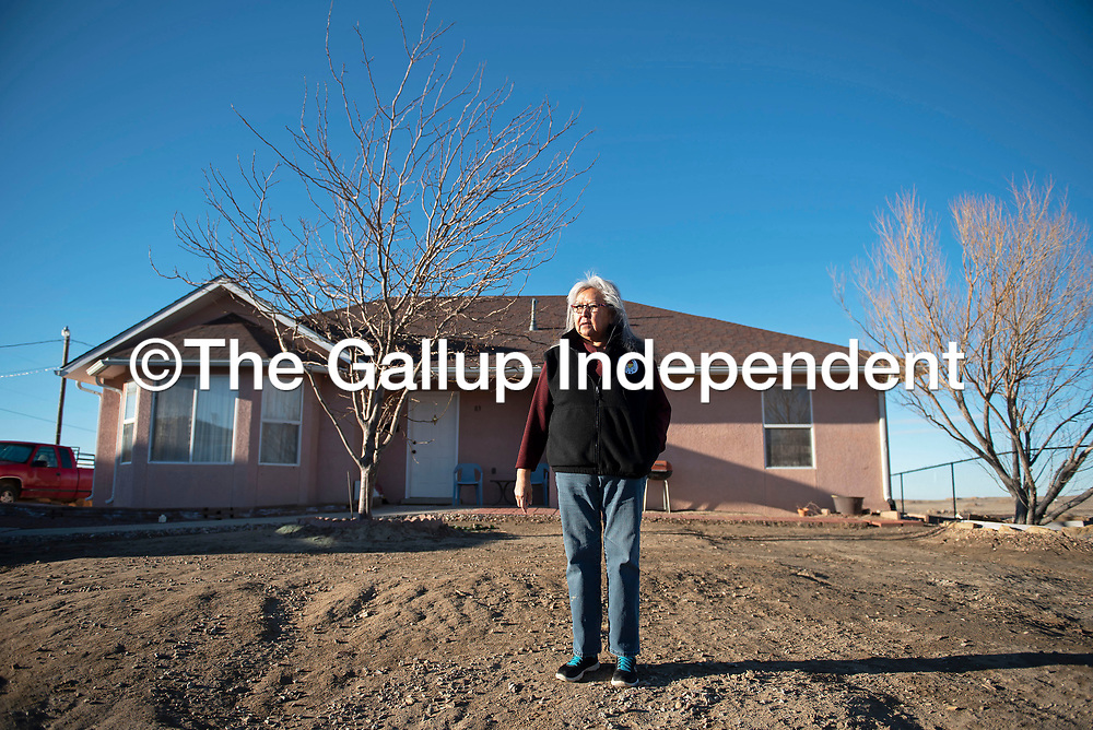 Phoebe Morgan stands in front of her home in the Tse'ii'ahi' Navajo Housing Authority Subdivision in Standing Rock, New Mexico Thursday. Morgan and other residents of the subdivision have been trying to meet with Navajo Housing officials to resolve multiple home repair issues.