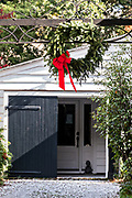 An evergreen Christmas wreath decorates a historic home at Meeting Street in Charleston, SC.