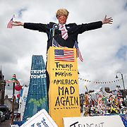 Donald Trump at Biggar Gala Day. Steve Ward a graphic designer from Biggar in South Lanarkshire pokes fun at Donald Trump as party of the float to celebrate the annual gala day to commemorate the Fleming Queen.  Every year he and his friends do a 'controversial' float, this year it was between the EU Referendum and Trump. The Donald won. Picture Robert Perry 18th June 2016<br /> <br /> Must credit photo to Robert Perry<br /> FEE PAYABLE FOR REPRO USE<br /> FEE PAYABLE FOR ALL INTERNET USE<br /> www.robertperry.co.uk<br /> NB -This image is not to be distributed without the prior consent of the copyright holder.<br /> in using this image you agree to abide by terms and conditions as stated in this caption.<br /> All monies payable to Robert Perry<br /> <br /> (PLEASE DO NOT REMOVE THIS CAPTION)<br /> This image is intended for Editorial use (e.g. news). Any commercial or promotional use requires additional clearance. <br /> Copyright 2014 All rights protected.<br /> first use only<br /> contact details<br /> Robert Perry     <br /> 07702 631 477<br /> robertperryphotos@gmail.com<br /> no internet usage without prior consent.         <br /> Robert Perry reserves the right to pursue unauthorised use of this image . If you violate my intellectual property you may be liable for  damages, loss of income, and profits you derive from the use of this image.
