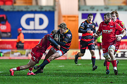 Dragons' Angus O'Brien is tackled by Scarlets' Aled Davies<br /> <br /> Photographer Craig Thomas/Replay Images<br /> <br /> Guinness PRO14 Round 13 - Scarlets v Dragons - Friday 5th January 2018 - Parc Y Scarlets - Llanelli<br /> <br /> World Copyright © Replay Images . All rights reserved. info@replayimages.co.uk - http://replayimages.co.uk