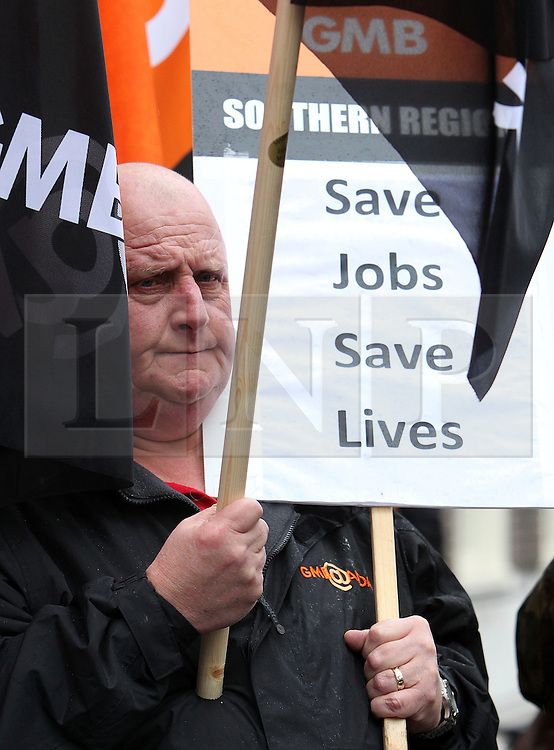 © Licenced to London News Pictures. 20/02/2014. London. UK.  <br /> Members of the General, Municipal, Boilermakers and Allied Trade Union (GMB) are pictured protesting against redundancies outside a meeting between<br /> unions and the Environment Agency in London, February 20th 2014.<br /> Photo Credit: Susannah Ireland