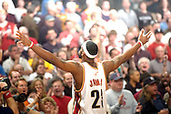 PHOTO BY DAVID RICHARD.LeBron James faces cheering fans before his first playoff game yesterday at Quicken Loans Arena.