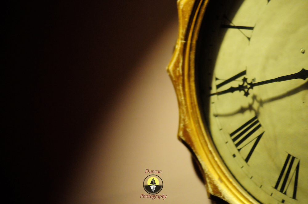 The fine clock ticks away the seconds. Image RELEASED by owner.  Photo by Roger S. Duncan.