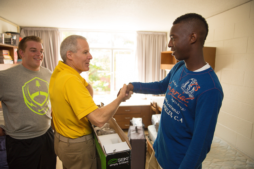 Valparaiso University President Mark Heckler helps move boxes during student move-in day on campus Saturday, August 24.