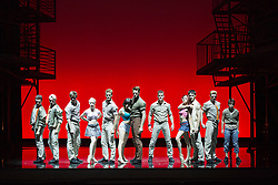 "© Licensed to London News Pictures. 07/08/2013. London, England. Pictured: Jet Girls and Jet Men dancing. The musical ""West Side Story"" returns to Sadler's Wells Theatre from 7 August to 22 September 2013 before embarking on a nationwide tour. Book by Arthur Laurents, music by Leonard Bernstein and lyrics by Stephen Sondheim. The entire original production directed and choreographed by Jerome Robbins. With Elena Sancho Pereg as Maria and Liam Tobin as Tony. Photo credit: Bettina Strenske/LNP"