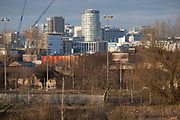 View looking down across overgrown and disused waste ground from Balsall Heath towards the City Centre and the iconic Rotunda building on 7th January 2021 in Birmingham, United Kingdom. Birmingham is undergoing a massive transformation called the Big City Plan which involves the controversial regeneration of the city centre as well as a secondary zone reaching out further. The Big City Plan is the most ambitious, far-reaching development project being undertaken in the UK. The aim for Birmingham City Council is to create a world-class city centre by planning for the next 20 years of transformation.