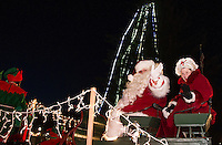 Santa and Mrs. Claus waves to children in the crowd following the tree lighting ceremony and Holiday Parade at Veteran's Square Sunday evening.   (Karen Bobotas/for the Laconia Daily Sun)