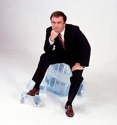 Male man executive sitting on block of ice contemplating copy space CONCEPT STOCK PHOTOS CONCEPT STOCK PHOTOS