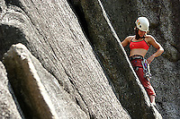 Young woman climbing in Squamish, BC, Canada.<br />