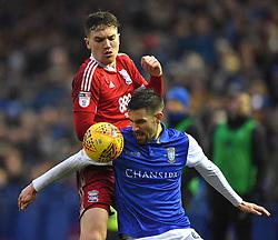 Birmingham City's Harlee Dean battles with Sheffield Wednesday's Frederico Venancio
