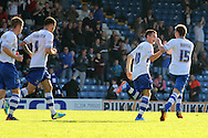 Bury's Jordan Sinnott and Dany Mayor celebrate Anton Forrester's (2nd left) goal as Bury draw 1-1. Skybet football league two match, Bury v Southend Utd at Gigg Lane in Bury, England on Sat 21st Sept 2013. pic by David Richards/Andrew Orchard sports photography