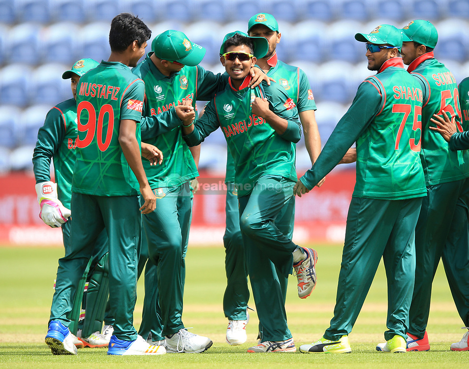 Bangladesh's Mosaddek Hossain (centre) celebrates after taking the wicket of New Zealand's James Neeshamduring the ICC Champions Trophy, Group A match at Sophia Gardens, Cardiff.