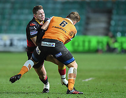 Dragons' Elliot Dee tackled by Cheetahs' Paul Schoeman<br /> <br /> Photographer Mike Jones/Replay Images<br /> <br /> Guinness PRO14 Round Round 18 - Dragons v Cheetahs - Friday 23rd March 2018 - Rodney Parade - Newport<br /> <br /> World Copyright © Replay Images . All rights reserved. info@replayimages.co.uk - http://replayimages.co.uk