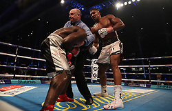 The ref steps in to stop the fight between Anthony Joshua and Carlos Takam during the IBF World Heavyweight Title, IBO World Heavyweight Title and WBA Super World Heavyweight Title bout at the Principality Stadium, Cardiff.