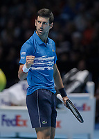 Tennis - 2019 Nitto ATP Finals at The O2 - Day One<br /> <br /> Singles Group Bjorn Borg: Novak Djokovic vs. Matteo Berrettini<br /> <br /> Novak Djokovic (Serbia) gives his bech a glance and fist pump after he breaks serve in the second set <br /> <br /> COLORSPORT/DANIEL BEARHAM