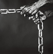 Detail of Hands holding Chain Links