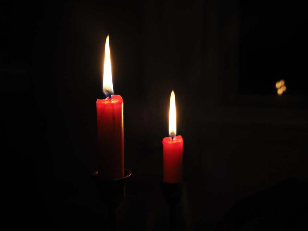 Evening with burining candles in Lysa nad Labem in Czech Republic.