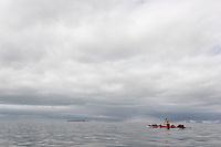 Man paddeling in Isfjorden, Svalbard