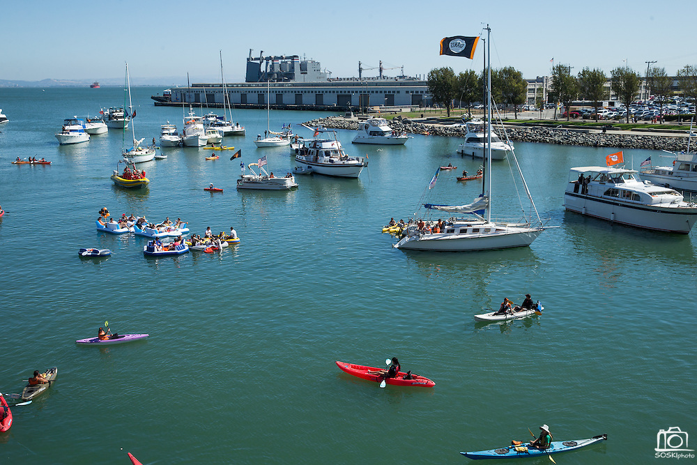 San Francisco Giants fans sit in the McCovey Cove during a game against the Los Angeles Dodgers at AT&T Park in San Francisco, Calif., on October 1, 2016. (Stan Olszewski/Special to S.F. Examiner)