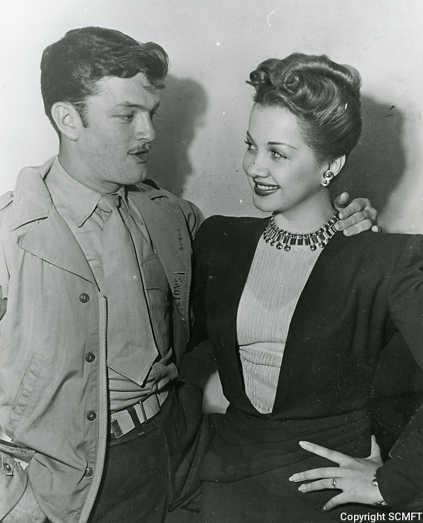 1944 Actress Olga San Juan chats with serviceman at the Hollywood Canteen
