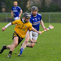 Both Cratloe's Cathal O'Connell and Cratloe's  Martin Oige Murphy have their eye on the slIotar