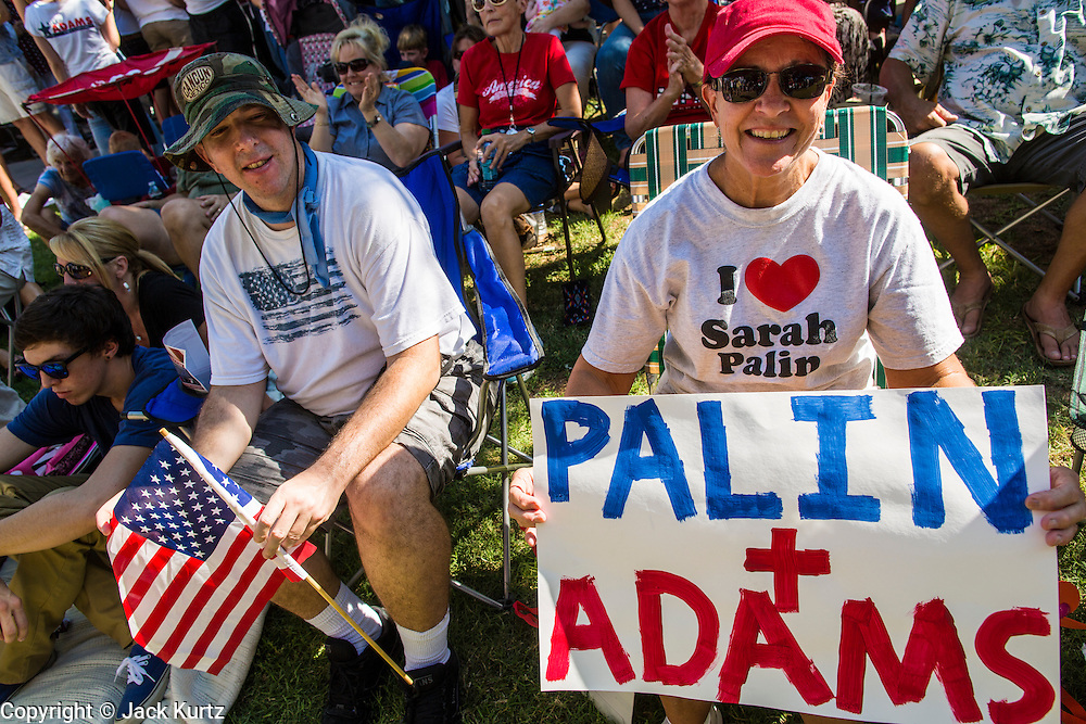 27 AUGUST 2012 - GILBERT, AZ:   JEAN FRAKES, from Gilbert, AZ, cheers for Sarah Palin Monday. Sarah Palin campaigned for Arizona Republicans aligned with the Tea Party movement at a barbecue in Gilbert, AZ, a suburb of Phoenix. She campaigned for Kirk Adams, who is running for Congress and Jeff Flake, who is running for US Senate. Palin spoke and served barbecued chicken in 108 degree heat.     PHOTO BY JACK KURTZ