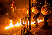 Public order, or riot, training takes place under realistic conditions, including stone, bottles and petrol bombs. All in a mock up urban landscape. Metropolitan Police Specialist Training Centre, Denton, <br /> Gravesend. <br /> Kent, UK. © Guy Bell Photography, GBPhotos