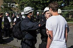 Bailiffs hold back a housing activist evicted from a property on the Sweets Way housing estate on 23rd September 2015 in London, United Kingdom. A group of housing activists calling for better social housing provision in London had occupied some of the properties on the 142-home estate in Whetstone, in some cases refurbishing properties intentionally destroyed by the legal owners following eviction of the original residents, in order to try to prevent the eviction of the last resident on the estate and the planned demolition and redevelopment of the entire estate by Barnet Council and Annington Property Ltd.