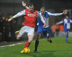 Bristol Rovers' David Clarkson chases down Morecambe's Mark Hughes - Photo mandatory by-line: Dougie Allward/JMP - Tel: Mobile: 07966 386802 14/12/2013 - SPORT - Football - Morecombe - Globe Arena - Morecombe v Bristol Rovers - Sky Bet League Two