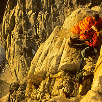 Chris Vandiver & Galen Rowell bask in dawn light after a long bivouac on Keeler Needle in California's Sierra Nevada.