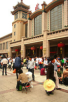 Beijing Railway Station opened in the 1950s, as can be seen from its architecture which merges traditional Chinese architecture with 50s design. . <br />