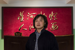 "© Licensed to London News Pictures. 03/03/2020. LONDON, UK. Cao Fei poses with her installation ""RMB City: A Second Life City Planning"", 2008. Preview of ""Blueprints"" by Cao Fei, a Chinese multi-media artist and filmmaker, based in Beijing.  The exhibition is the artist's first large-scale solo show in the UK, features works from 2006-2020 including her first virtual reality work. The show takes place at the Serpentine Gallery 4 March to 17 May 2020.  Photo credit: Stephen Chung/LNP"