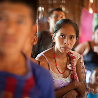 A woman stands with others in her community to listen to a marimba band in Concepción Actelá, Alta Verapaz. World Renew is beginning to work in Concepción Actelá, through its Guatemalan partner ADIP.