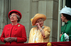 File photo dated 08/05/95 of Queen Elizabeth II (left) alongside the Queen Mother (centre) and Princes Margaret (right) on the balcony of Buckingham Palace to greet the thousands of people who had gathered to commemorate the 50th anniversary of VE Day.