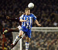 Photo: Chris Ratcliffe.<br />Arsenal v Wigan Athletic. Carling Cup. 24/01/2006.<br />Neil Mellor of Wigan gets above Kerrea Gilbert