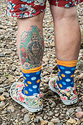 A tattoo on the leg of American artist Anado McLauchlin outside the Chapel of Jimmy Ray in his art compound Casa las Ranas September 28, 2017 in La Cieneguita, Mexico.