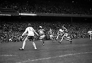 Kerry catches the ball as Tyrone player comes at him fast from the front during the All Ireland Minor Gaelic Football Final, Tyrone v Kerry in Croke Park on the 28th September 1975.