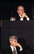 US Treasury Secretary Robert Rubin (bottom) and IMF Director Michel Camdessus listen to President Bill Clinton address the opening session of the International Monetary Fund World Bank annual meeting October 6, 1998 in Washington, DC.